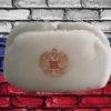 Шапка ушанка сувенирная из искусственного меха белая вид спереди с кокардой российский герб