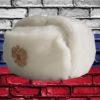 Шапка ушанка сувенирная из искусственного меха белая вид сбоку права с кокардой российский герб